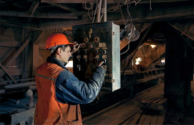 Mine worker using the electrical system.