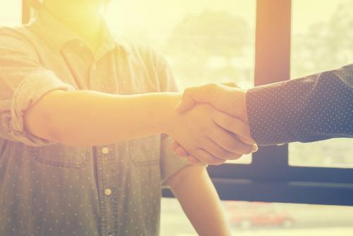 Men shaking hands, strong reputation management